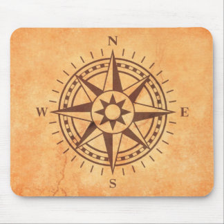 Brown compass rose on stone wall texture mousepad