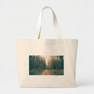 Brown Dirt Road Between Green Leaved Trees Daytime Large Tote Bag