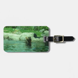 Brown Grizzly Bear swimming in a Pond by Trees Luggage Tag