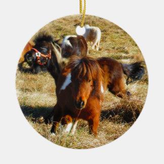 Brown miniature horses running ceramic ornament
