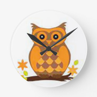 brown owl sitting in a branch wall clock