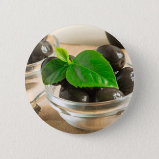Brown pickled olives in a transparent cups 2 inch round button