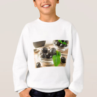 Brown pickled olives on the old wooden background sweatshirt