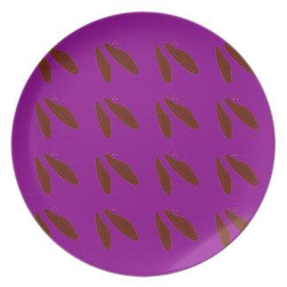 Brown purple beans. Design beans. Plate