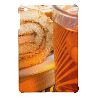 Brown sponge cake and cup of hot tea cover for the iPad mini