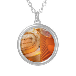 Brown sponge cake and cup of hot tea silver plated necklace