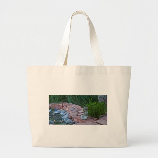 Buda meditating by the stream bag