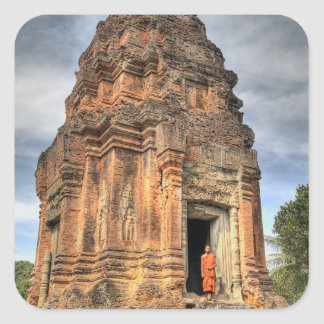 Buddhist monk standing in doorway of temple square sticker