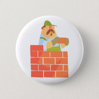 Builder Laying A Brick Wall On Construction Site 2 Inch Round Button