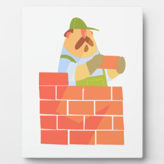 Builder Laying A Brick Wall On Construction Site Plaque