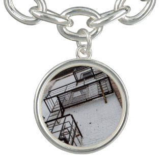 Building with fire escapes and graffiti charm bracelets