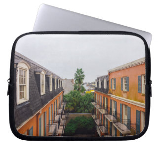 Buildings and Palm Trees in New Orleans Laptop Sleeves