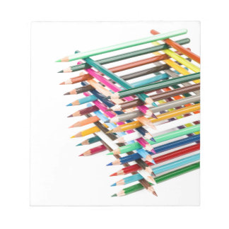 Built square construction of colored crayons notepads