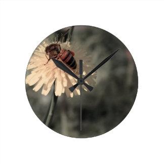 Bumblebee on flower round clock