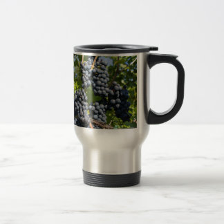 Bunch of blue grapes travel mug