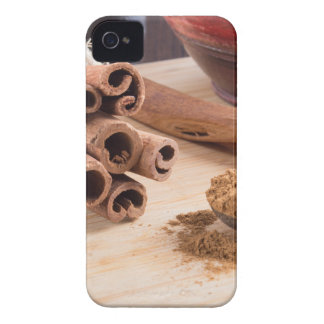 Bunch of cinnamon sticks and vintage silver spoon Case-Mate iPhone 4 cases