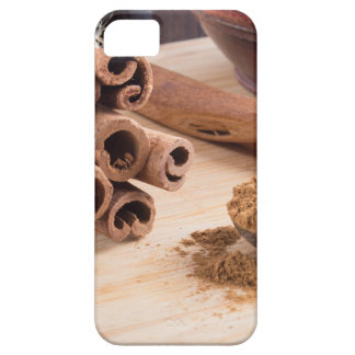Bunch of cinnamon sticks and vintage silver spoon iPhone 5 cover