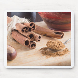 Bunch of cinnamon sticks and vintage silver spoon mouse pad