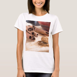 Bunch of cinnamon sticks and vintage silver spoon T-Shirt