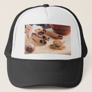 Bunch of cinnamon sticks and vintage silver spoon trucker hat