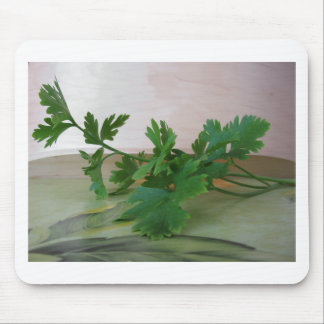 Bunch of fresh parsley on the table mouse pad