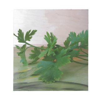 Bunch of fresh parsley on the table notepad