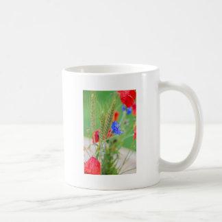Bunch of of red poppies, cornflowers and ears coffee mug