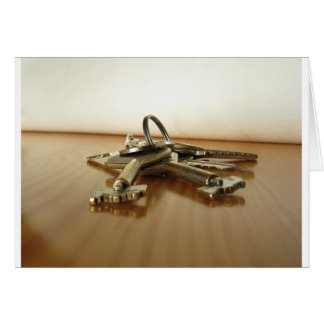 Bunch of worn house keys on wooden table card