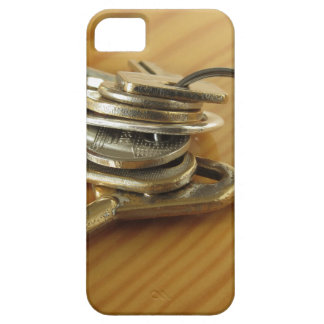 Bunch of worn house keys on wooden table case for the iPhone 5