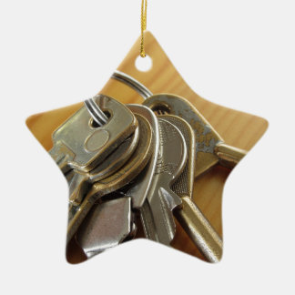 Bunch of worn house keys on wooden table ceramic ornament