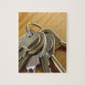 Bunch of worn house keys on wooden table jigsaw puzzle