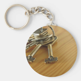 Bunch of worn house keys on wooden table keychain
