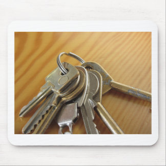 Bunch of worn house keys on wooden table mouse pad