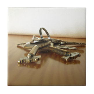 Bunch of worn house keys on wooden table tile