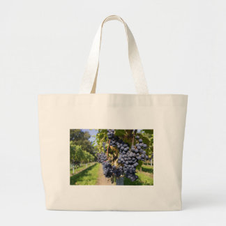 Bunches of blue grapes with path large tote bag