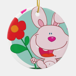 Bunny holds flower round ceramic ornament