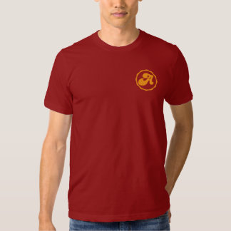 Burgundy t shirt with yellow emblem on right chest