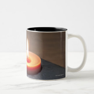 Burning candle flame with rocks in tranquil Two-Tone mug