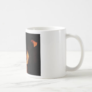 Burning fireplace with fire flames coffee mug