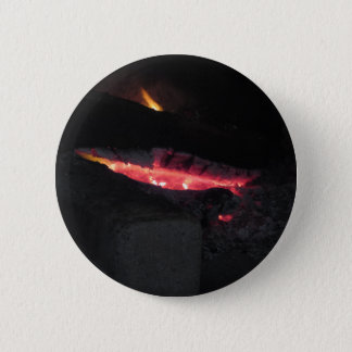 Burning fireplace with fire flames on black 2 inch round button