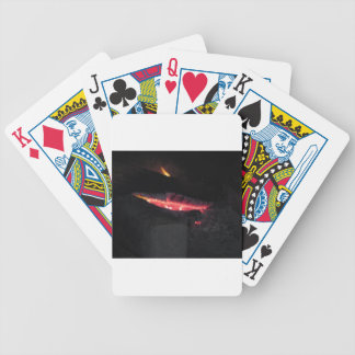 Burning fireplace with fire flames on black bicycle playing cards