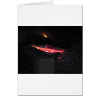 Burning fireplace with fire flames on black card