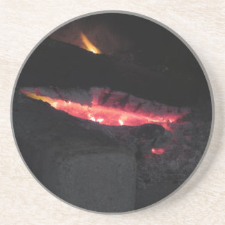 Burning fireplace with fire flames on black coaster