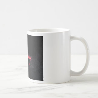 Burning fireplace with fire flames on black coffee mug