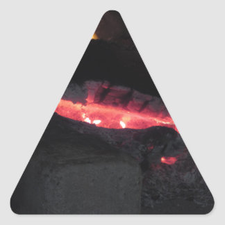 Burning fireplace with fire flames on black triangle sticker