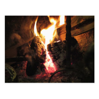 Burning fireplace with fire flames postcard