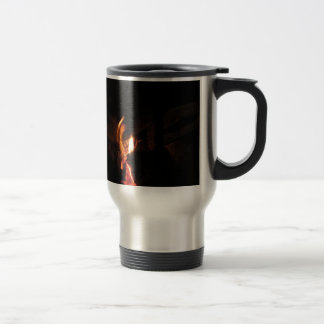 Burning fireplace with fire flames travel mug