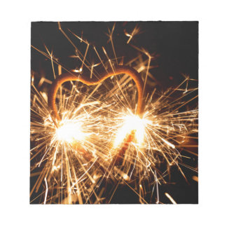 Burning sparkler in form of a heart notepad