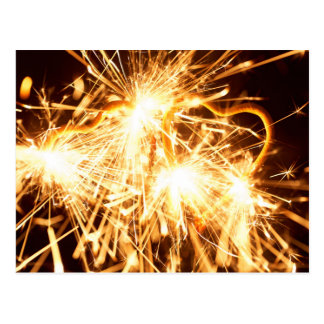 Burning sparkler in form of a heart postcard