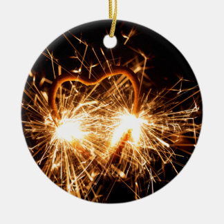 Burning sparkler in form of a heart round ceramic ornament